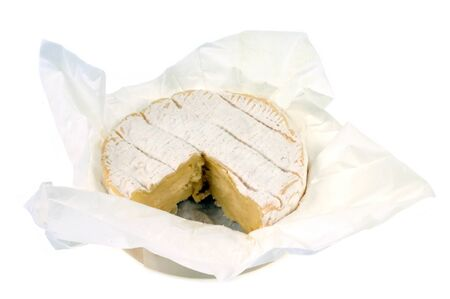 Camembert in its packaging on a white background