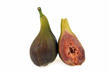 Whole fig and fig cut in half on white background Stockfoto