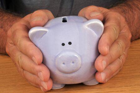 Radin holding his piggy bank close up
