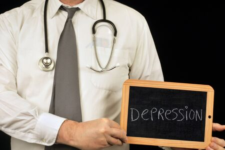 Anonymous doctor holding a school slate on which is written depression