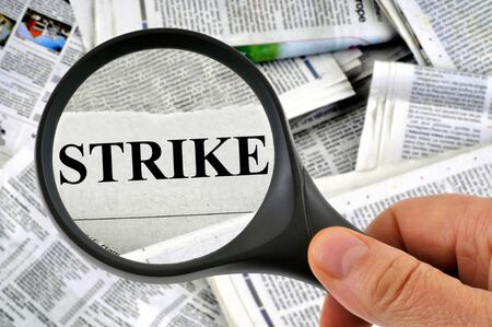Strike examined with a magnifying glass