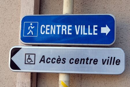 Signs indicating the city center in French for disabled and disabled people