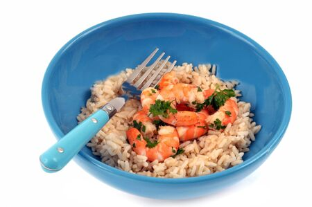 Plate of rice with shrimps on a white background