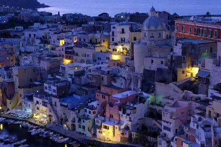 Corricella fishing village on the island of Procida at night Stock Photo