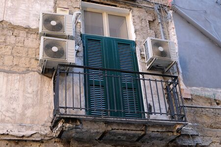 Air conditioners on the facade of a building in Naples Italy Stock Photo - 131796871