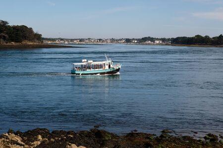 Boat carrying passengers on the Gulf of Morbihan Stock Photo