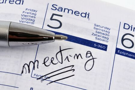 Meeting noted on an agenda Stock Photo - 131794878