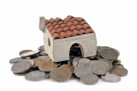 House on coins on a white background Stock Photo