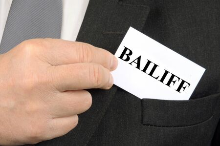 Bailiff business card in a pocket Stock Photo