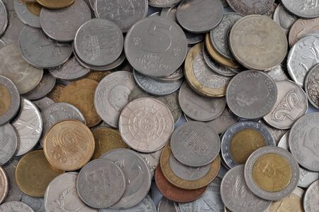 Coins of different countries in close up Stock Photo - 132391187