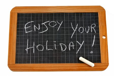 Enjoy your holiday written on a school slate