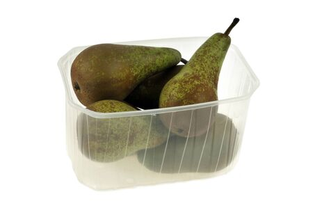 Plastic tray of pears in closeup on white background