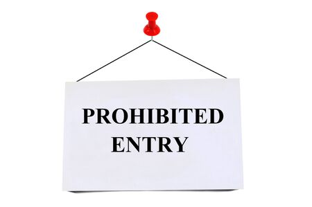 Prohibited entry written on a card pinned on white background Stock Photo