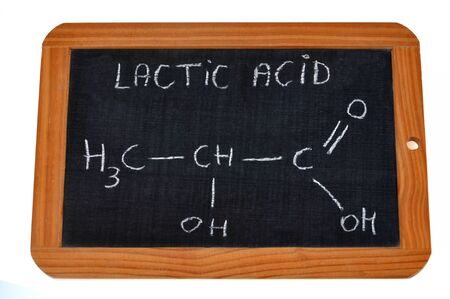 Chemical formula of lactic acid written on a school slate