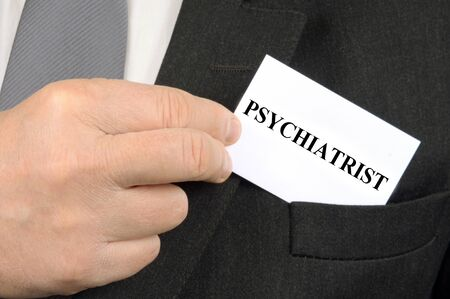 psychiatrist business card in a jacket pocket