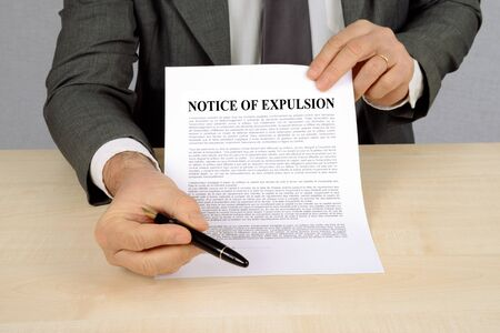 Bailiff presenting a notice of expulsion Stock Photo