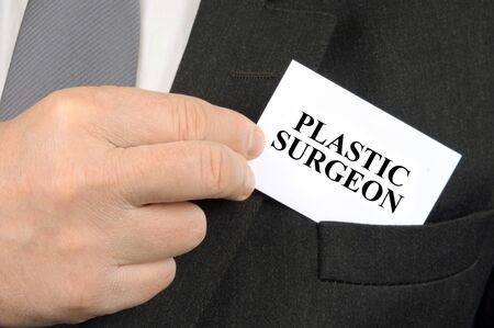 Business card of plastic surgeon close up in the pocket of a jacket Stock Photo