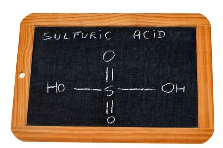 Chemical formula of sulfuric acid written on a school slate Stock Photo