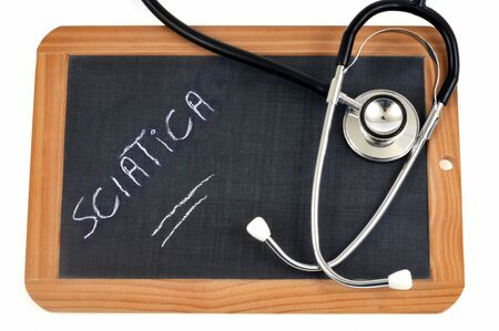 Sciatica writing on a school slate with a stethoscope Stock Photo
