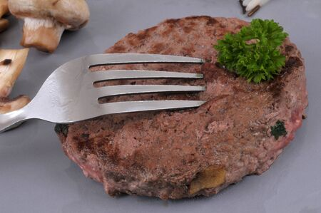 Ground beef steak with parsley in close-up
