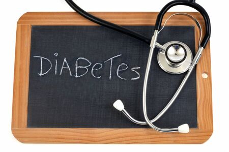 Diabetes written on a school slate Stock Photo