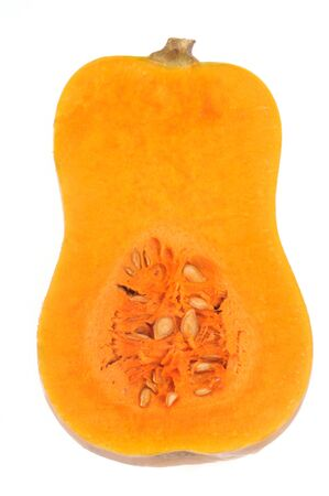 Raw butternut cut in half in close-up on white background Stock Photo
