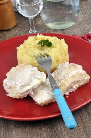 Cod and mashed potatoes in a plate close up Stock Photo