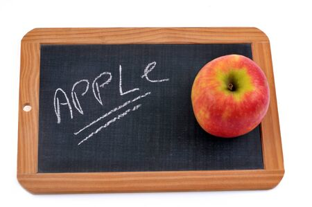 Apple written on a school slate