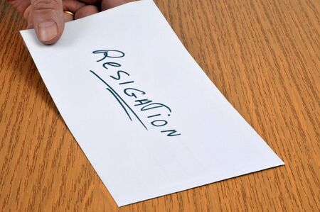 Give his resignation letter in close-up