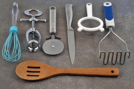 Kitchen utensils on gray background Stock fotó