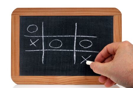 Play the tic-tac-toe game on a school slate with chalk
