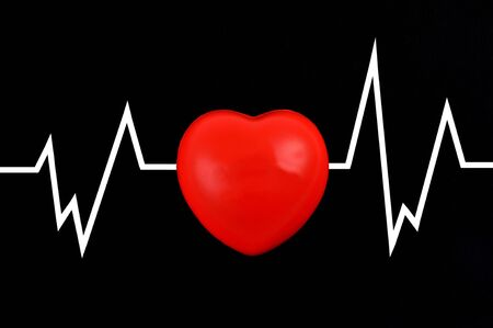 Cardiogram concept with heart on black background Stock Photo