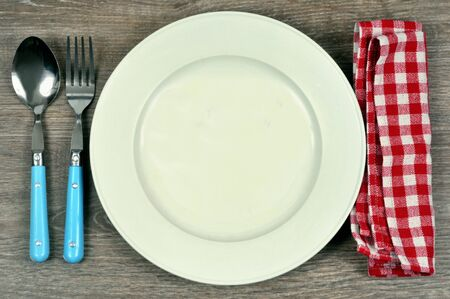 Plate with cutlery and a napkin close-up Stock Photo