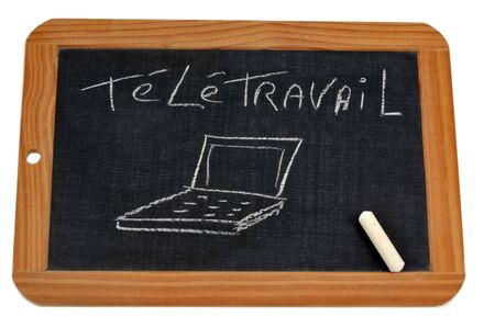 Telecommuting written on a school slate with chalk Stock Photo