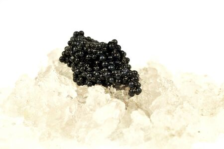 Caviar on crushed ice close up on white background Banco de Imagens