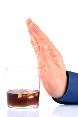 Man refusing a glass of alcohol on white background