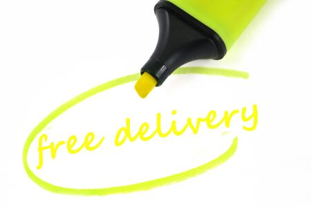 Free delivery written in neon felt in close-up on white background Banco de Imagens