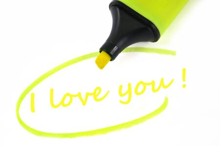 I love you written in neon felt in close-up on white background