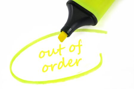 Out of order written in neon felt in close-up on white background