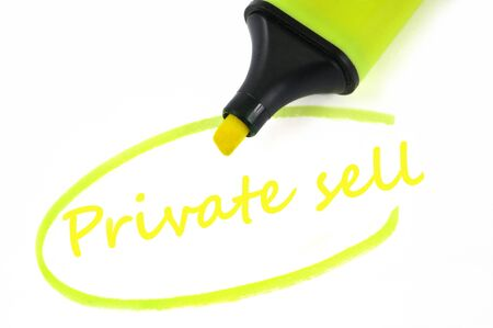 Private sell written in neon felt in close-up on white background
