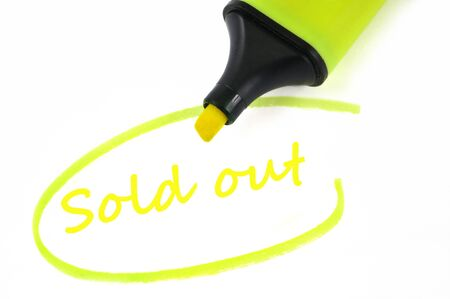 Sold out written in neon felt in close-up on white background