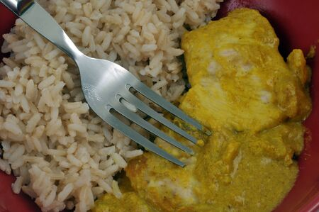 Diet meal with fish curry with rice close-up Фото со стока