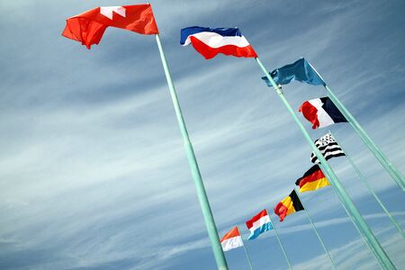 Flags of different countries fluttering in the wind  Фото со стока
