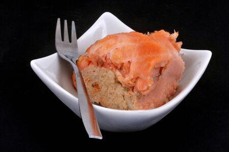 Amuse-bouche with a salmon paupiette on black background Stockfoto