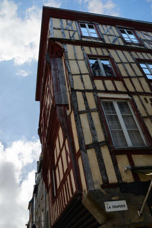 Half-timbered house in Dinan in Brittany Редакционное