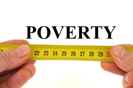 Poverty measurement concept close-up on white background