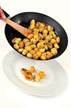 Serve hash browns on a plate on white background
