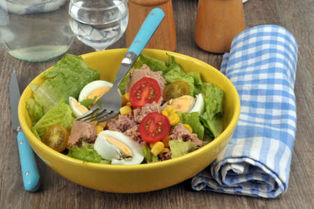 Mixed salad served on a plate on a table Фото со стока