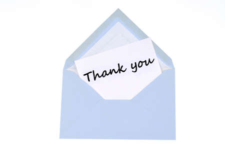 Thank you written on a card in an envelope on a white background