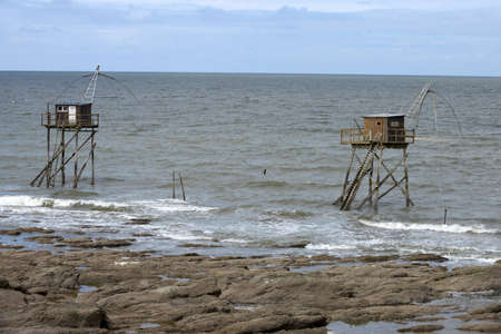 Carrelet fishing huts on Comberge beach in Saint-Michel-Chef-Chef